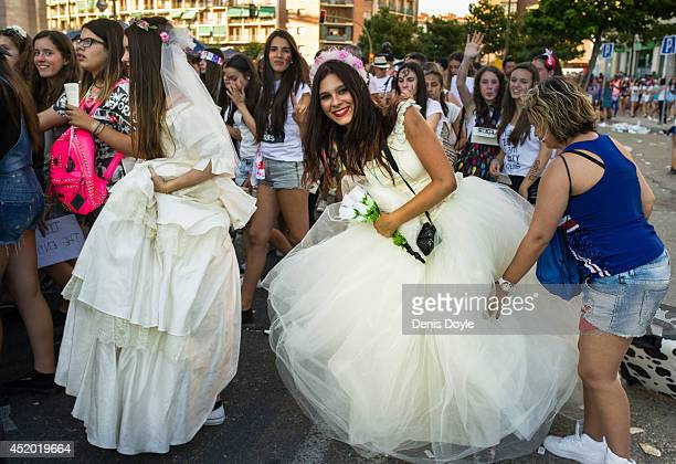 Fans wearing wedding dresses wait in long lines outside the Vicente Calderon stadium for the first of two shows by the British and Irish band One...