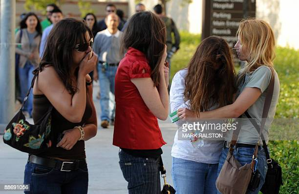 Fans weep and console each other outside outside the UCLA Medical Center following the death of music legend Michael Jackson on June 25, 2009 in Los...