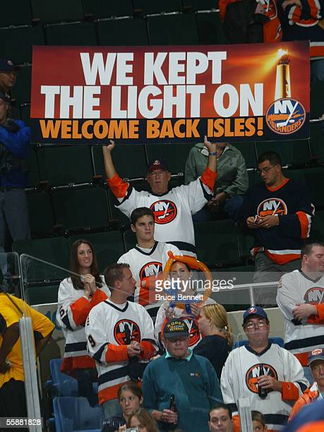Fans welcome the New York Islanders back for their home opener against the Carolina Hurricanes on October 8, 2005 at the Nassau Coliseum in...