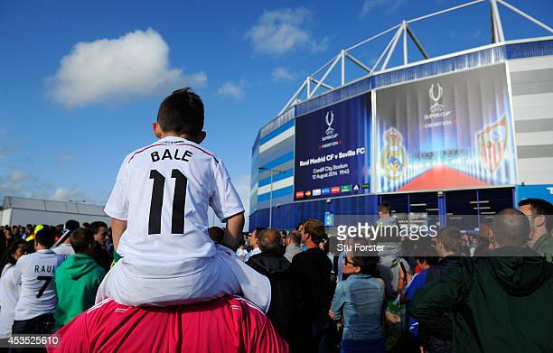 Fans welcome the Real Madrid bus before the UEFA Super Cup match between Real Madrid and Sevilla FC at Cardiff City Stadium on August 12 2014 in...