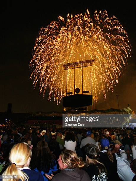 Fans who attended the game between the Los Angeles Dodgers and the San Francisco Giants watch a post game fireworks display from the outfield grass...