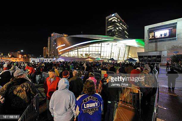 Fans who have lined up for days wait to get into the NASCAR Hall of Fame on Saturday morning February 9 2013 in Charlotte North Carolina