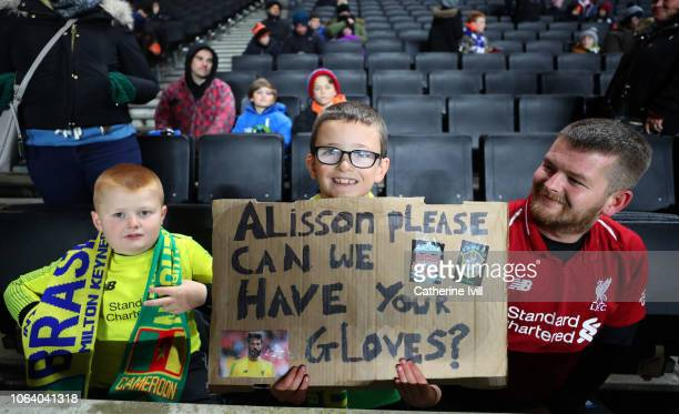 Fans with a sign asking for the gloves of goalkeeper Alisson of Brazil during the International Friendly match between Brazil and Cameroon at Stadium...
