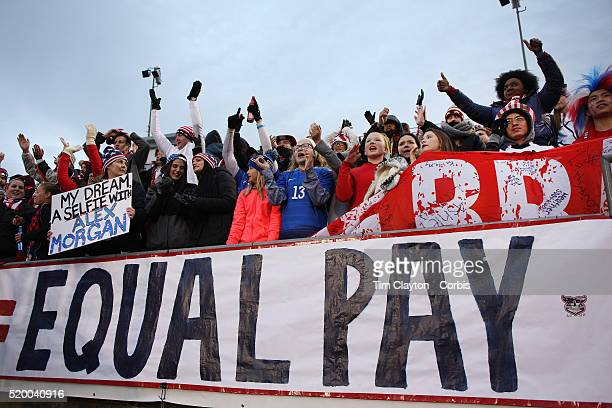 USA fans with an 'Equal Play Equal Pay' banner supporting the women players fight for equal pay with their male counterparts during the USA Vs...
