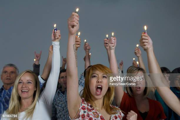 fans with lighters - cigarette lighter stock pictures, royalty-free photos & images