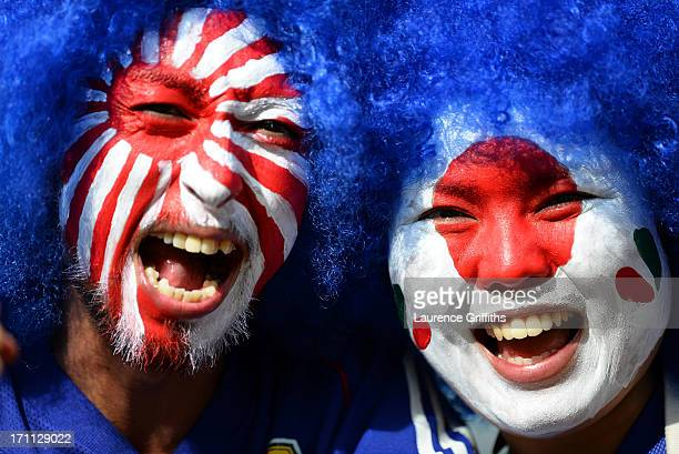 Fans with painted faces pose for a photo during the FIFA Confederations Cup Brazil 2013 Group A match between Japan and Mexico at Estadio Mineirao on...