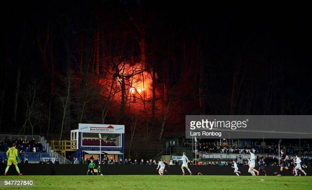 Fans with pyrotechnics in a forest outside the stadium during the Danish Alka Superliga match between FC Helsingor and AGF Aarhus at Helsingor...