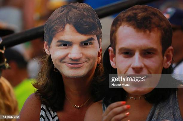 Fans with Roger Federer and Andy Murray masks pose during a singles match between Victoria Azarenka of Belarus and Polona Hercog of Slovenia as part...