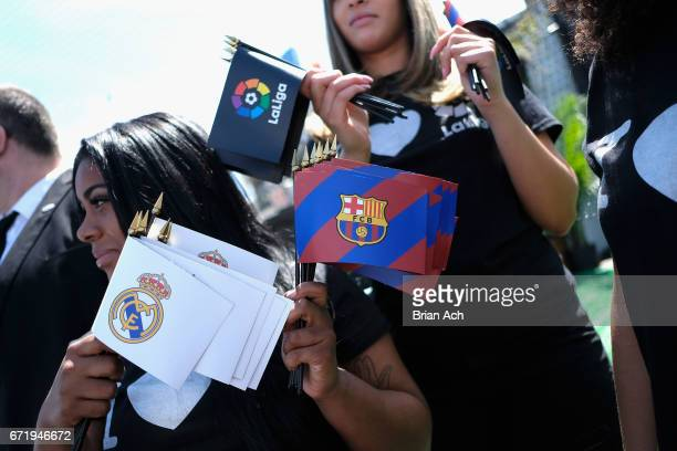 Fans with the logos of the competing soccer clubs are handed out at a roofop viewing party of El Clasico Real Madrid CF vs FC Barcelona hosted by...