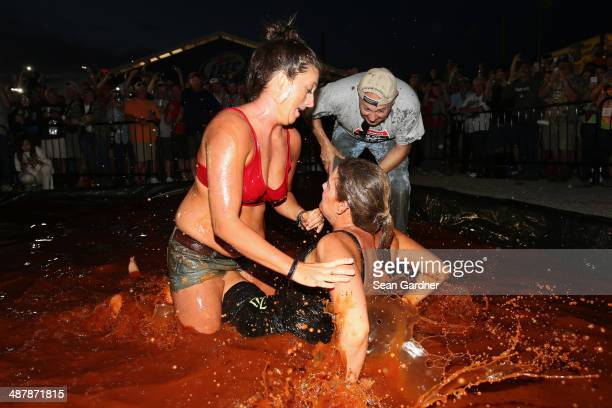 Fans wrestle in barbecue sauce in the infield following qualifying for the NASCAR Nationwide Series Aaron's 312 at Talladega Superspeedway on May 2,...