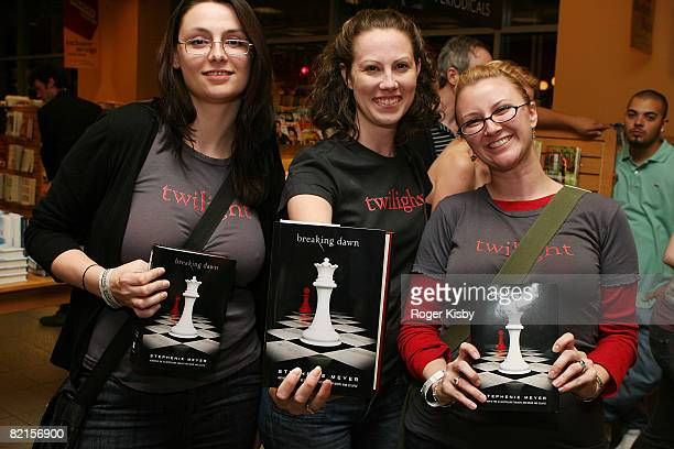 Fans/customers purchase the fourth book, 'Breaking Dawn' in the 'Twilight' series at the 'Breaking Dawn' Midnight Release Party at Borders, Michigan...