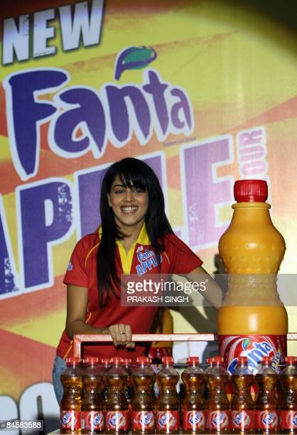 Fanta Brand Ambassador and Actress Genelia D'Souza poses with bottles of Fanta Apple during its national launch in New Delhi on February 2 2009...