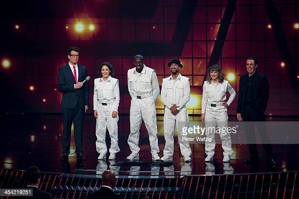 Fantastic 5 together with host Daniel Hartwich during the second Semifinal of 'Das Supertalent' TV Show on December 07 2013 in Cologne Germany