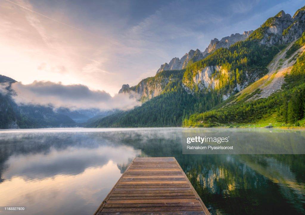 Fantastic Sunrise Scene with Fog Over Lake at azure alpine lake Vorderer Gosausee. Gosau valley in Upper Austria : Stock Photo