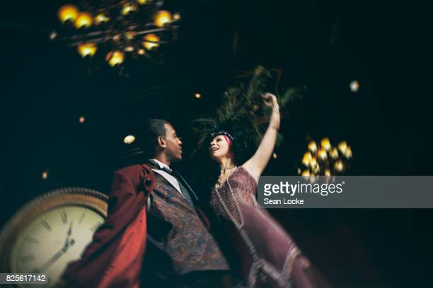fantasy: actor and actress dance around stage - flapper stock photos and pictures