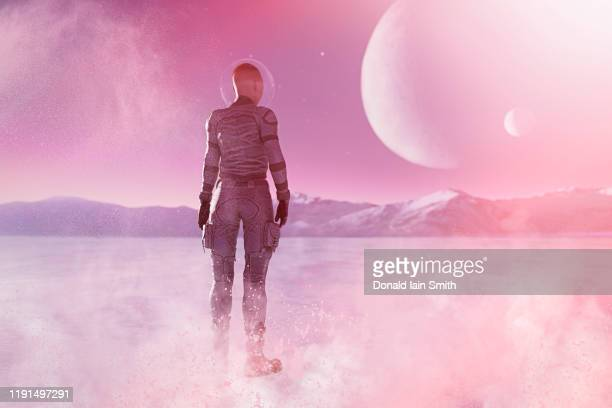 fantasy female space explorer astronaut on another planet - space suit stock pictures, royalty-free photos & images
