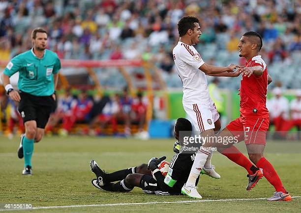 Faouzi Aaish of Bahrain and Walid Abbas of the United Arab Emirates come together during the 2015 Asian Cup match between Bahrain and the UAE at...
