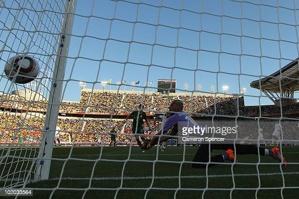 Faouzi Chaouchi of Algeria misjudges the flight of the ball and allows Robert Koren of Slovenia to score from long range during the 2010 FIFA World...