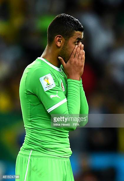 Faouzi Ghoulam of Algeria reacts after the 12 defeat in the 2014 FIFA World Cup Brazil Round of 16 match between Germany and Algeria at Estadio...