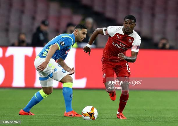 Faouzi Ghoulam of Napoli and Ainsley MaitlandNiles of Arsenal during the UEFA Champions League quarterfinals second leg football match SSC Napoli v...