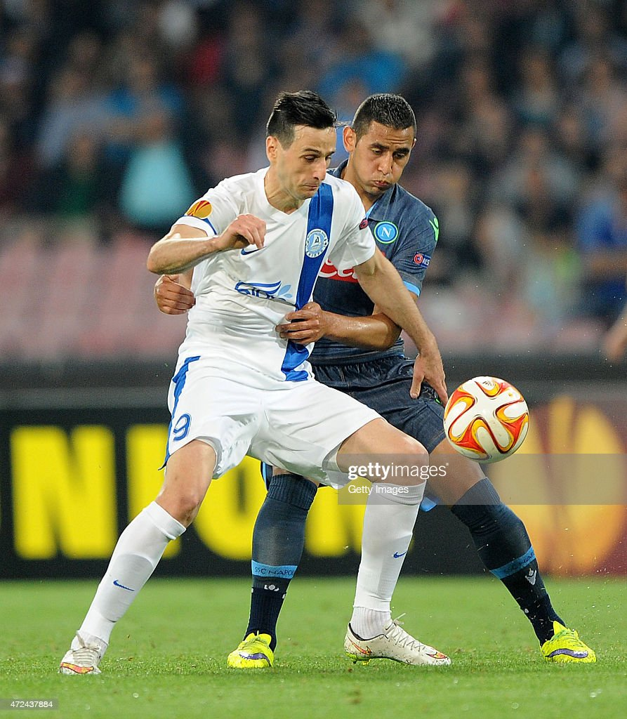 Faouzi Ghoulam of Napoli vies with Nikola Kalinic of FC Dnipro Dnipropetrovsk during the UEFA Europa League Semi Final between SSC Napoli and FC Dnipro Dnipropetrovsk on May 7, 2015 in Naples, Italy.