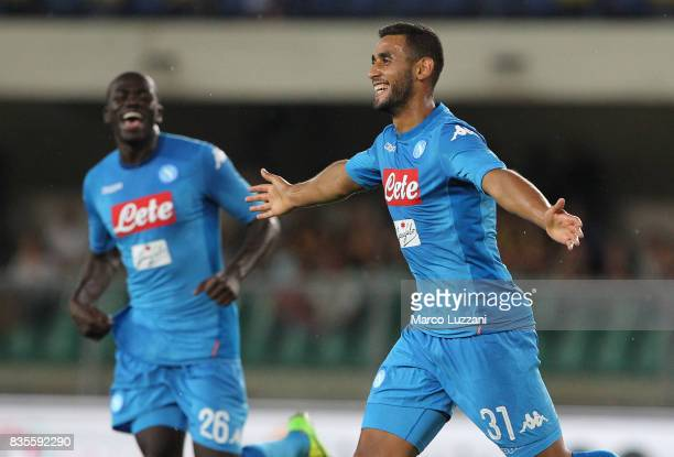 Faouzi Ghoulam of SSC Napoli celebrates his goal during the Serie A match between Hellas Verona and SSC Napoli at Stadio Marcantonio Bentegodi on...
