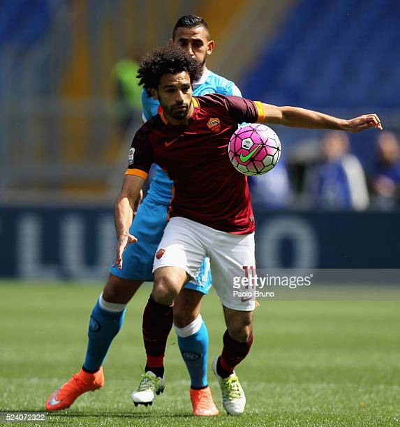 Faouzi Ghoulam of SSC Napoli competes for the ball with Mohamed Salah of AS Roma during the Serie A match between AS Roma and SSC Napoli at Stadio...