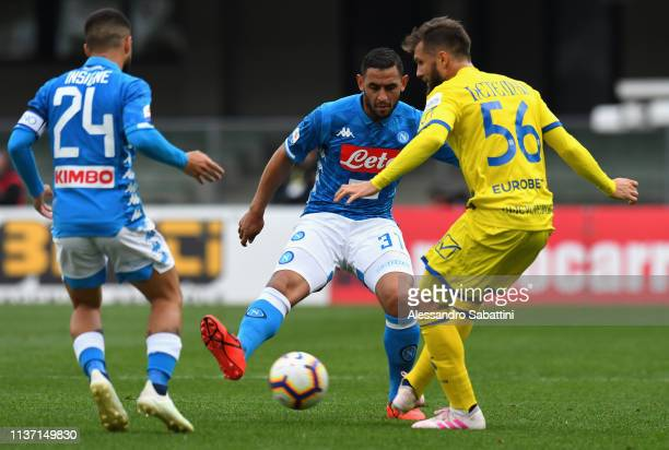 Faouzi Ghoulam of SSC Napoli competes for the ball with Perparim Hetemaj of Chievo Verona during the Serie A match between Chievo Verona and SSC...
