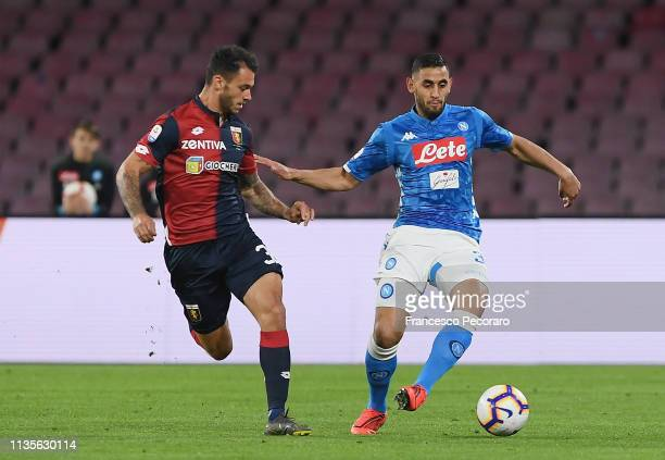 Faouzi Ghoulam of SSC Napoli vies Pedro Pereira of Genoa CFC during the Serie A match between SSC Napoli and Genoa CFC at Stadio San Paolo on April 7...