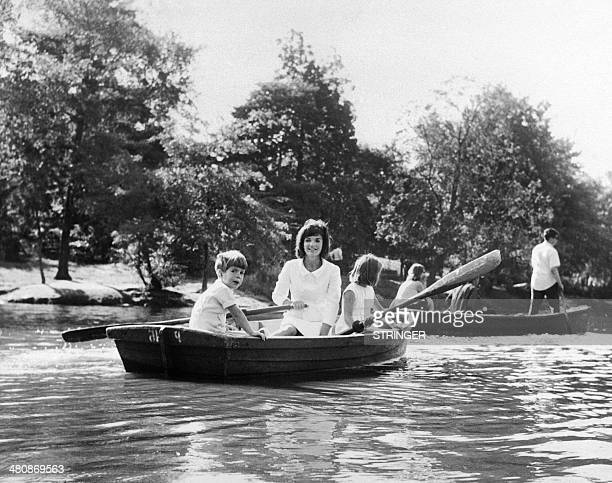 Far away from the US electoral campaign Jacqueline Kennedy and her children Johnjohn and Caroline go boating in Central Park New York on September 16...