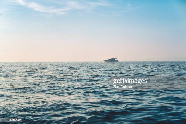 far away from the yacht - navy blue stock pictures, royalty-free photos & images