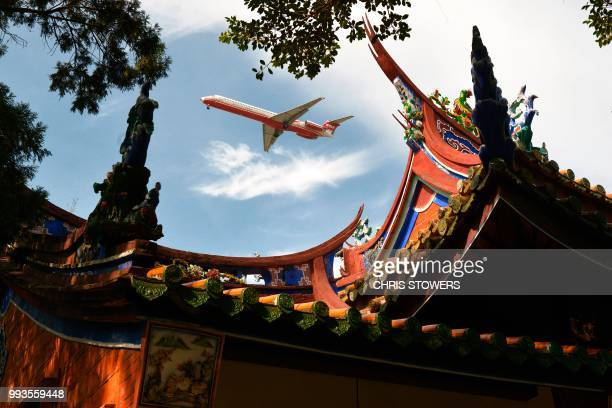 Far Eastern Air plane flies over the Confucius Temple in Taipei on July 8, 2018.