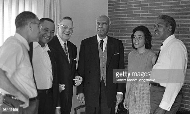 Far left Nobel Prizewinning political scientist and diplomat Ralph Bunche stands next to Chicago Defender Publisher John Henry Sengstacke in a group...
