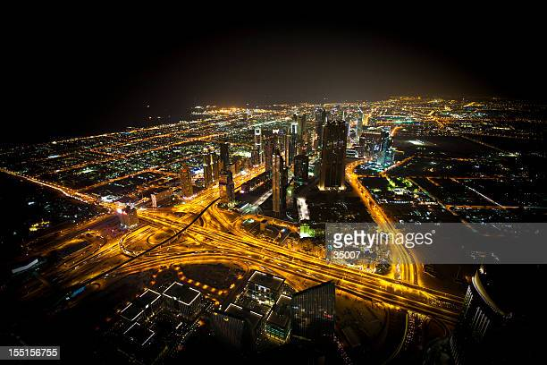Far off aerial view of illuminated Dubai at night