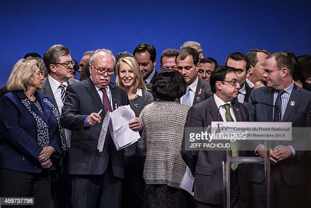 Far right Front National party's member of parliament Marion MarechalLe Pen poses on the tribune after being elected at the FN central committee...