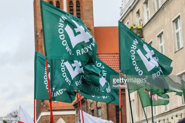 Far right nacionalist organization ONR members with Falanga flags are seen during the Cursed soldiers Day parade on 26 February 2017 in Gdansk Poland...