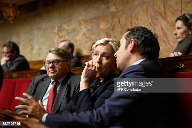 Far right party Front National deputees Gilbert Collard Marine Le Pen and Sebastien Chenu attend a session of questions to the government at the...