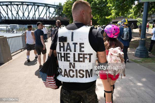 A far right protester marches through Tom McCall Waterfront Park as part of the Patriot Prayer Rally The Proud Boys organized the Patriot Prayer...