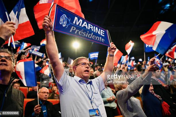 Far right supporters attend the launch of National Front Leader Marine Le Pen presidential campaign launch on February 5 2017 in Lyon France One of...