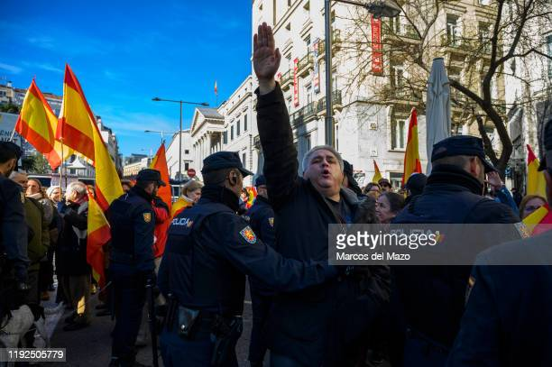 Far right wing supporter making a nazi salute protesting outside Spanish Parliament during the second vote of the investiture against the socialist...
