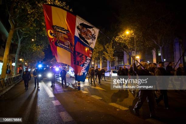Far Right wing supporter waves a preconstitutional Spanish flag during a rally to commemorate the 82nd death anniversary of Falange founder Jose...