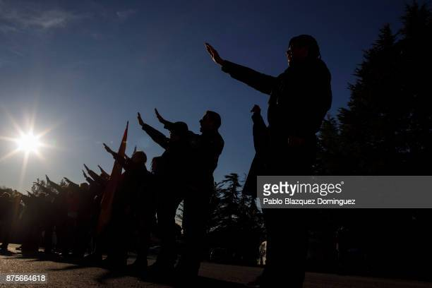 Far right wing supporters do a fascist salute at the end of the 'Crown March' outside the Valley of the Fallen to commemorate the 81st death...