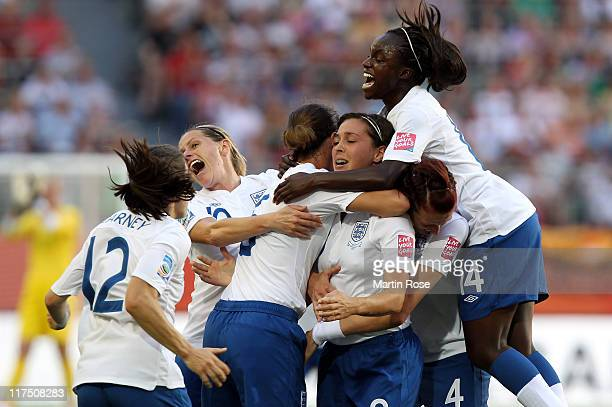 Fara Williams celebrate with her team mates after she scores her team's opening goal of England battle for the ball during the FIFA Women's World Cup...