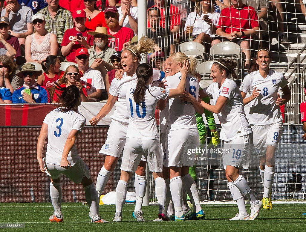 Fara Williams #4 of England celebrates team mate Lucy Bronze's #12 (not pictured) goal against Canada with teammates during the FIFA Women's World Cup Canada 2015 Quarter Final match between the England and Canada June, 27, 2015 at BC Place Stadium in Vancouver, British Columbia, Canada.
