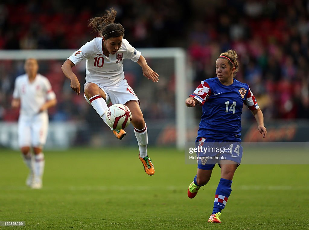 Fara Williams of England controls the ball infront of Andrea Martic of Croatia during the UEFA Women's EURO 2013 Group 6 Qualifier between England and Croatia at the Bank's Stadium on September 19, 2012 in Walsall, England.