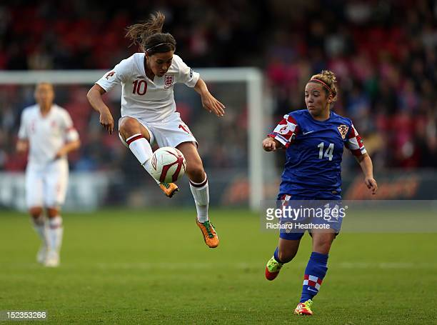 Fara Williams of England controls the ball infront of Andrea Martic of Croatia during the UEFA Women's EURO 2013 Group 6 Qualifier between England...