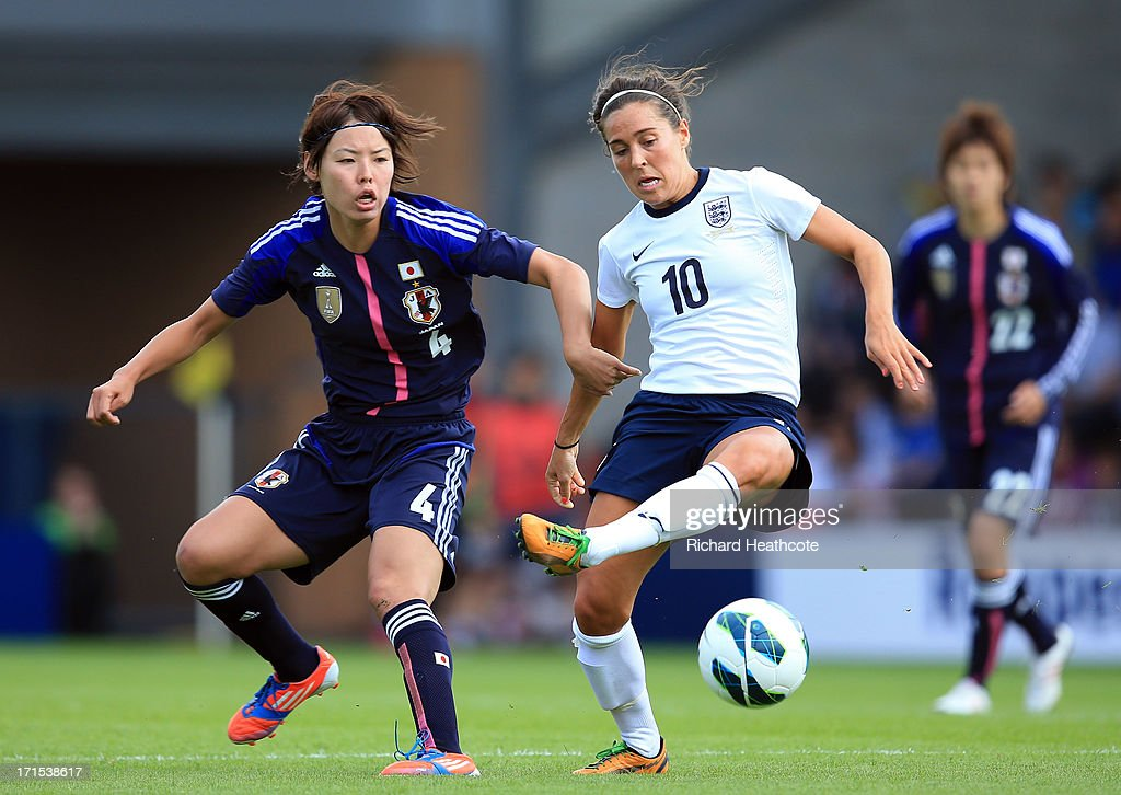 Fara Williams of England holds off Saki Kumagai of Japan during the Women's International match between England and Japan at the Pirelli Stadium on June 26, 2013 in Burton-upon-Trent, England.
