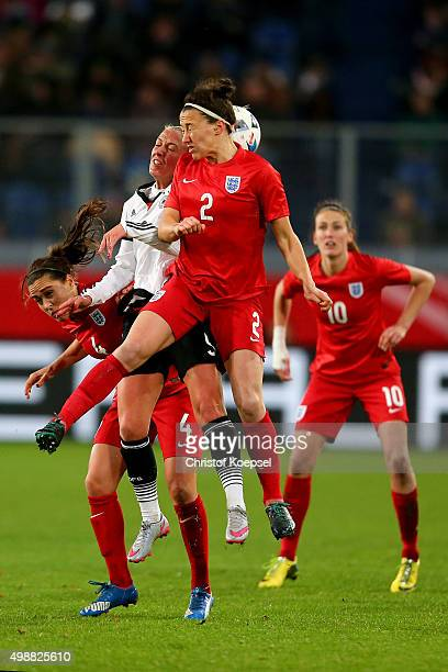 Fara Williams of England Mandy Islacker of Germany and Lucy Bronze of England go up for a header during the Women's International Friendly match...