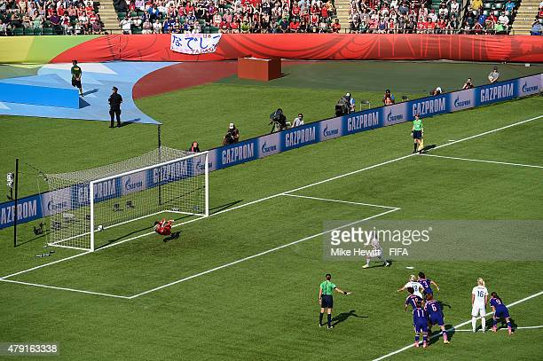 Fara Williams of England scores from the penalty spot despite the best efforts of Ayumi Kaihori of Japan during the FIFA Women's World Cup 2015 Semi...