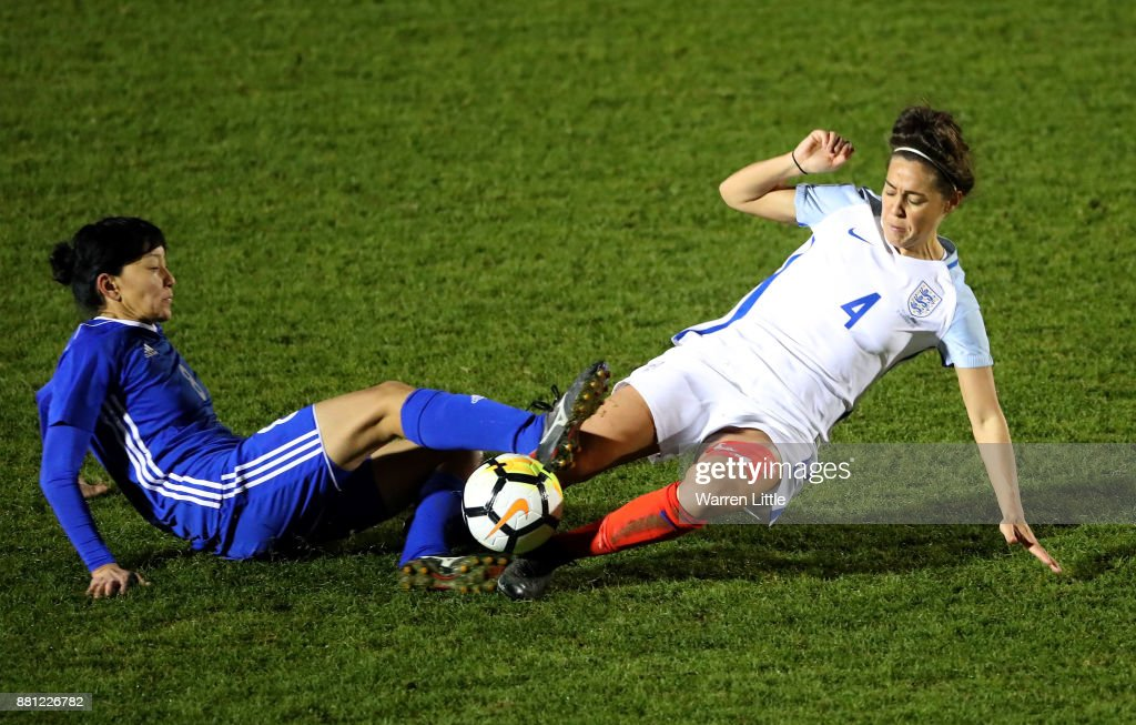 Fara Williams of England tackles Begaim Kirgizbaeva of Kazakhstan during the FIFA Women's World Cup Qualifier match between England and Kazakhstan at the Weston Homes Community Stadium on November 28, 2017 in Colchester, England.